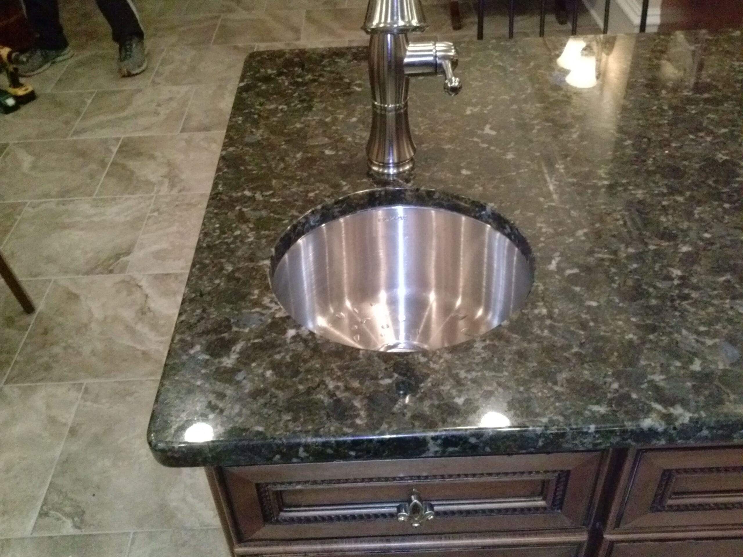 Sink cutout in granite by Upgrade Cabinets
